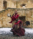 Rodemack france december actress disguised as cave woman dancing outside near fortress walls sleeting historical reenactment Stock Image