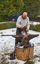 Rodemack france december aedieval blacksmith hammering piece hot red fire outside winter reenactment historical festival rodemack Royalty Free Stock Photo