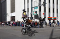 Rodeo clown in national western stock show parade cycling down street at the annual nwss kick off january downtown denver th Stock Photos