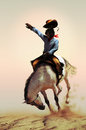 Rodeo cowboy on a wild white horse bucking over the sand Stock Image
