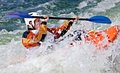 Rodeo kayaking an active male kayaker rolling and surfing in rough water Stock Photography