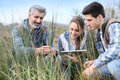 Rofessor with agronomy students outdoors Royalty Free Stock Photo