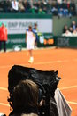 Roland garros broadcasted on tv picture of a cameraman filming a tennis player at Stock Photo