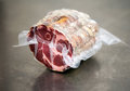 Roll of air cured pork on table Royalty Free Stock Photo
