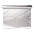 Roll of aluminium foil paper over isolated white background Royalty Free Stock Photo