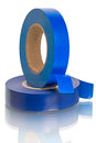 Roll of blue insulating tape isolated on a white background Royalty Free Stock Photography