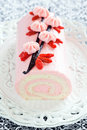 Roll cake with strawberry cream, vanilla, and goji berries Royalty Free Stock Photo
