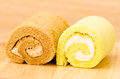 Roll cake on wooden background Royalty Free Stock Images