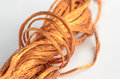 stock image of  A roll of copper wire on white background.