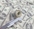Roll of dollars in Calipers Royalty Free Stock Images