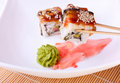 Roll with eel and sesame ginger and wasabi Royalty Free Stock Images