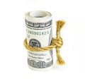 Roll of hundred dollar bills related golden rope in knot on white background Stock Photos