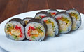 Roll made with chicken eggs and vegetables japanese sushi Stock Photos