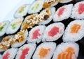 Roll made salmon eel tuna vegetables japanese sushi sat Stock Photo