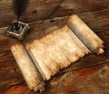 Roll of parchment on wooden table 3D still-life Stock Photo