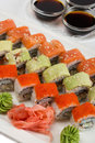 Roll philadelphia unagi roll uramaki roll with flying fish roe soy sauce Stock Photos