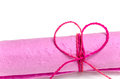 Roll of pink mulberry paper tied with rope in heart shape isolated on white background Royalty Free Stock Photography
