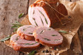 Roll pork stuffed with sage close up on the table. horizontal Royalty Free Stock Photo