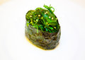 Roll with seaweed green side view tasty on a plate grains vegetarian menu useful Royalty Free Stock Images
