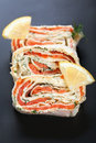 Roll with smoked salmon, cream cheese and dill Stock Images
