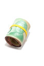 Roll of twenty canadian dollars on white background with yellow plastic band over the Royalty Free Stock Photo
