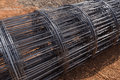 Roll of wire mesh on construction site Stock Photos