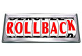 Rollback word rolling back time price save money roll words on an odometer or roll to illustrate discounting or saving in a store Royalty Free Stock Photos