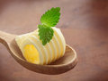 Rolled butter curl on a wooden spoon Royalty Free Stock Photo