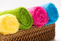 Rolled, colorful towels in a basket Royalty Free Stock Photo