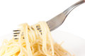 Rolled on a fork spaghetti isolated white background Stock Image