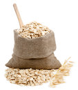 Rolled oats in a bag isolated on white Royalty Free Stock Photo