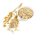 Rolled oats in a bowl and spoon Stock Images