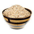 Rolled oats in a ceramic plate over white background Stock Photo