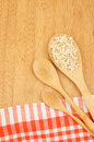 Rolled oats spoon kitchen table Stock Photography