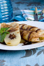 Rolled pancakes with poached pear Royalty Free Stock Photography