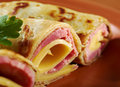 Rolled pancakes stuffed ham and cheese. Royalty Free Stock Image