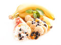 Rolled pancakes with sweet cream and fruits Stock Photos