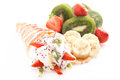 Rolled pancakes with sweet cream and fruits Royalty Free Stock Image