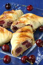 Rolled pastry with cherries Stock Photography