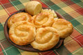 Rolled potato pies on clay plate Stock Photo