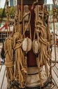 Rolled rope and pulleys supported on the central mast of a sailing ship on a cloudy day in Amsterdam. Royalty Free Stock Photo