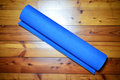 Rolled rubber mat an entire and ready to be used for the fitness exercises Royalty Free Stock Photography