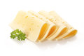 Rolled slices of cheese garnished with parsley Royalty Free Stock Photo