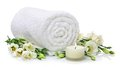 Rolled towel with flowers Royalty Free Stock Photos