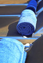 Rolled towels on sunbeds Royalty Free Stock Photo