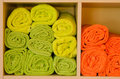 Rolled-up colorful towels in a shelf Royalty Free Stock Photo