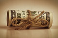 Rolled up hundred dollar banknote tied twine Stock Images