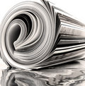 Rolled up magazine Royalty Free Stock Image