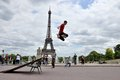 Roller boy in front of eiffel tower paris active jumping near france Stock Photos