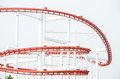 Roller coaster red loop ride at funfair theme park Royalty Free Stock Photography